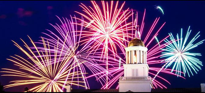 old capitol with fireworks behind it